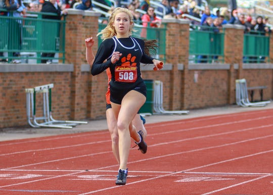 Kennedy Smith crosses the finish line to give Brighton the victory in the 800-meter relay in the KLAA track and field meet on Friday, May 10, 2019.