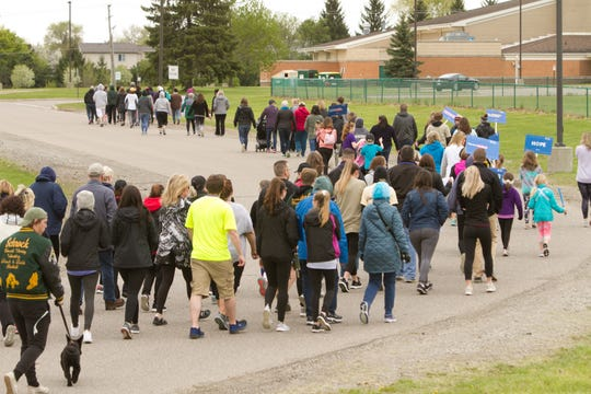 """Participants in an """"Out of the Darkness Campus Walk"""" head out on the course of an awareness and fundraising walk for suicide prevention, leaving Howell High School Saturday, May 11, 2019."""