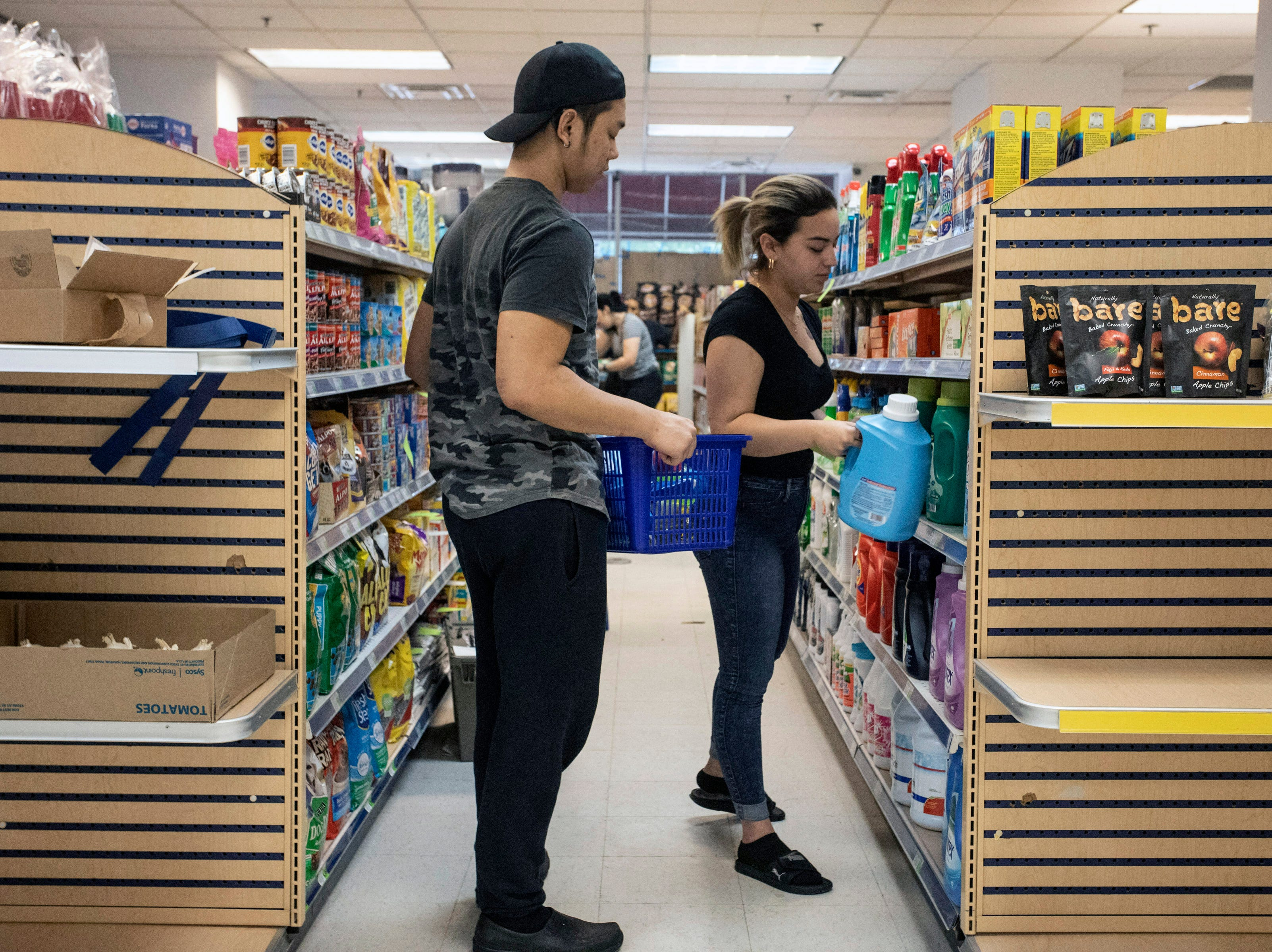 Stockers at the Superior Market & Deli sort, arrange, and fill the shelves of the 5,400-square-foot bodega with items on Friday morning. 5/10/19