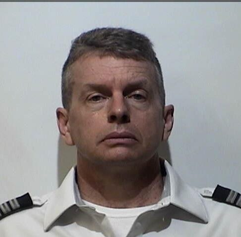 Airline pilot charged with killing 3 in 2015 in Kentucky; arrested at Louisville airport