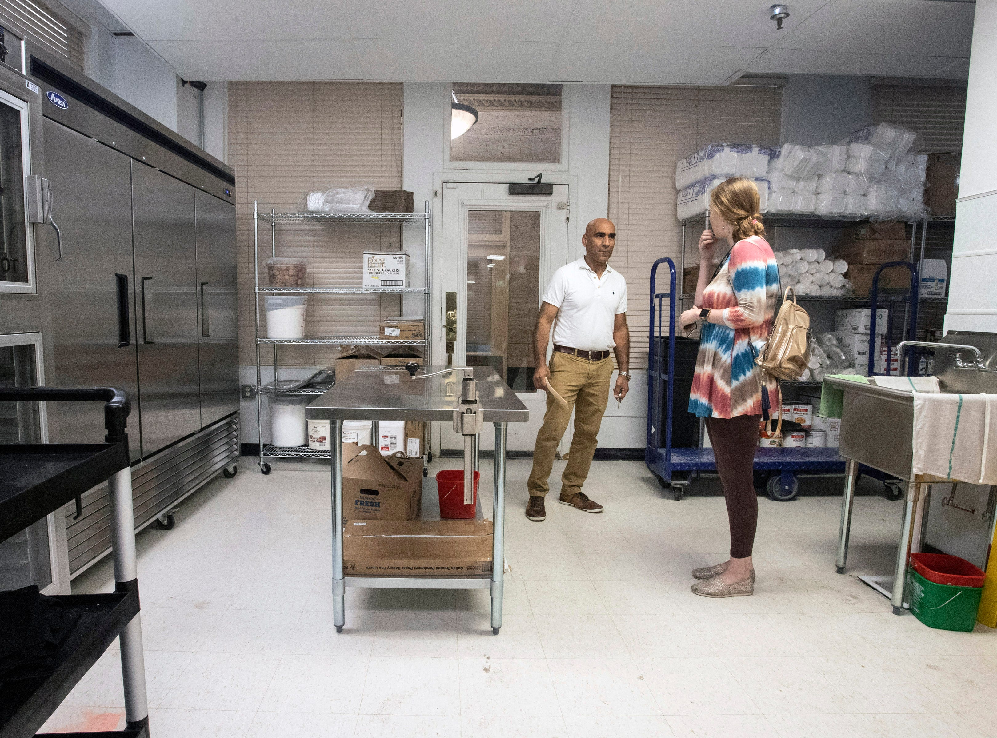 Superior Market & Deli owner Abdul Alshawi shows off the kitchen in his new 5,400-square-foot New York-style bodega at Third & Broadway. 5/10/19