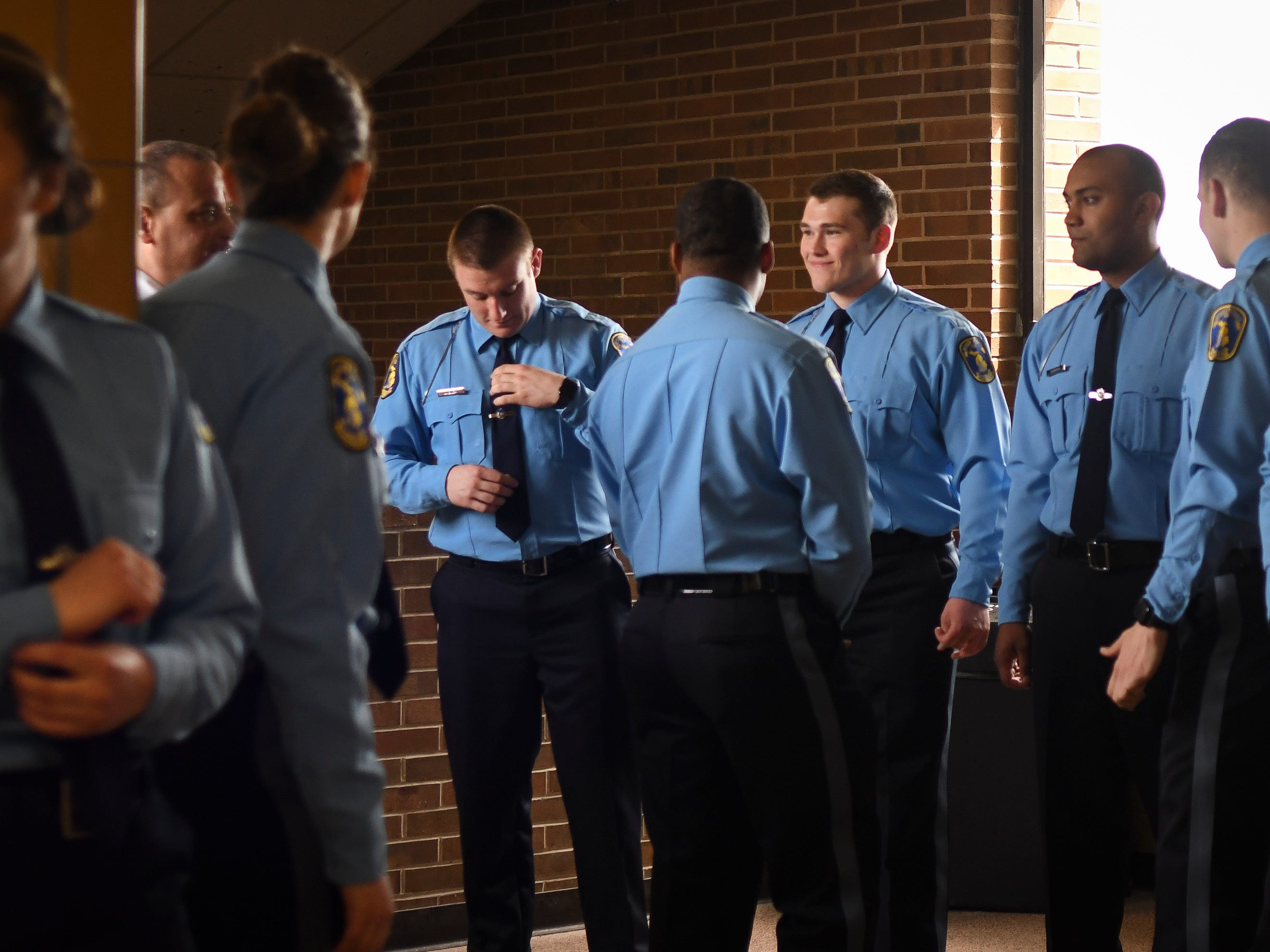 Young men and women wearing Lansing Police Department blues prepare for their swearing in ceremony, Monday, May 6, 2019, at the LPD Special Operations Center in Lansing.