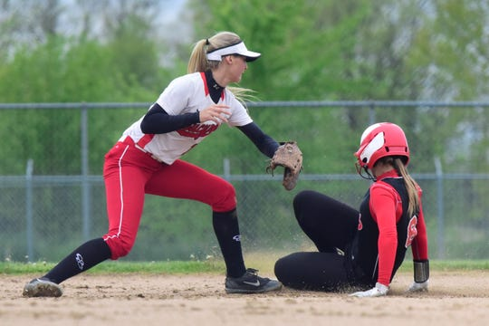 Crestview catcher Paige Schaefer safely steals second Friday as Bucyrus shortstop Alexis Dye reaches to apply the tag. Bucyrus won, 3-0.