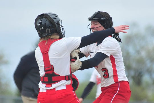 Bucyrus pitcher Caleigh Rister, right, celebrates with her catcher, Laurell Kohler, Friday evening after defeating Crestview, 3-0.