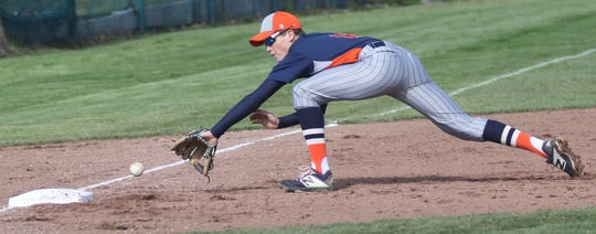 Galion's Troy Manring makes an incredible back-handed play at third base during the Tigers' loss to Ontario on Saturday.