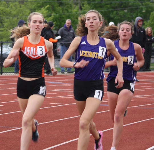 Carina Weaver set a meet record for her repeat title in the 3200, helping the Lexington girls dethrone Madison for the Ohio Cardinal Conference championship.