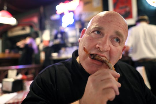 Brad Schmitt of The Tennessean digs in to some Rendezvous ribs as he tours several Memphis barbecue joints Friday, May 10, 2019.