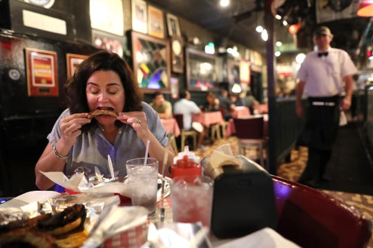 Jennifer Chandler of The Commercial Appeal digs into the ribs at Rendezvous during a tour of Memphis barbecue on Friday, May 10, 2019.
