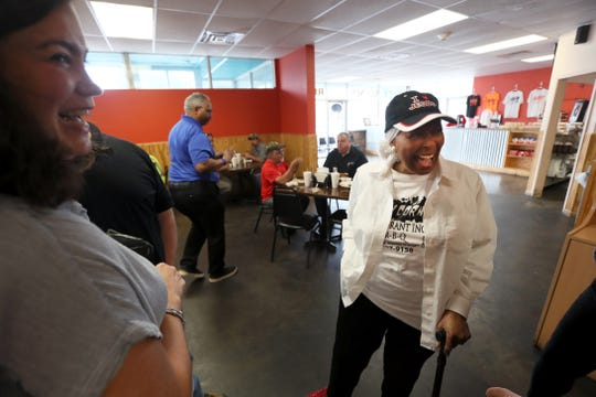 Desiree Robinson, right, owner of Cozy Corner, laughs with food writer Jennifer Chandler during a tour of Memphis barbecue joints Friday, May 10, 2019.