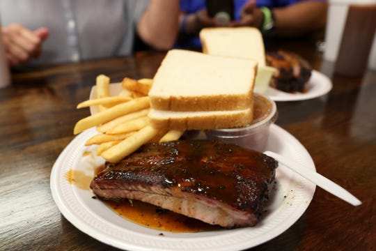 Gannett food writers Brad Schmitt of The Tennessean and Jennifer Chandler of The Commercial Appeal hit Cozy Corner during a tour of Memphis barbecue on Friday, May 10, 2019.