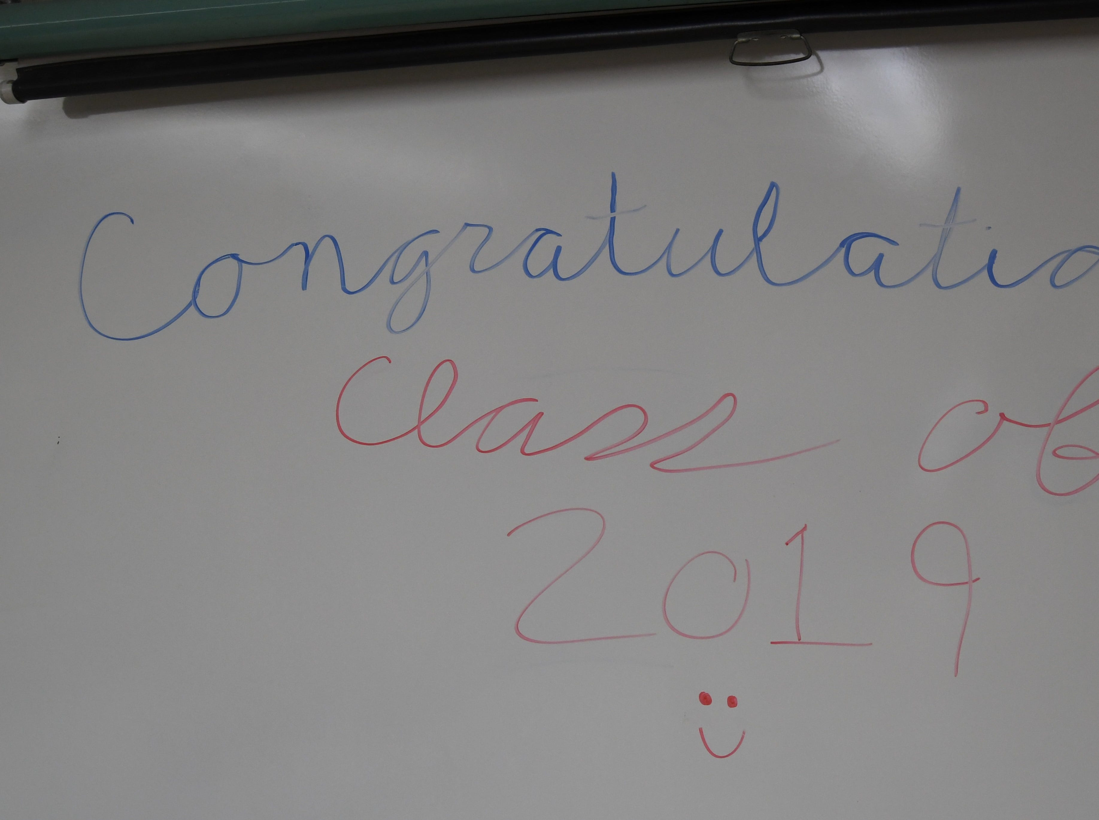 The whiteboard in the classroom of Gina Riggs congratulates the members of Flippin's Class of 2019.