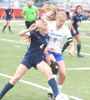 Mountain Home's Chloe Nosari (6) battles Little Rock Christian's Darby Stotts (4) during state quarterfinal action Friday evening.
