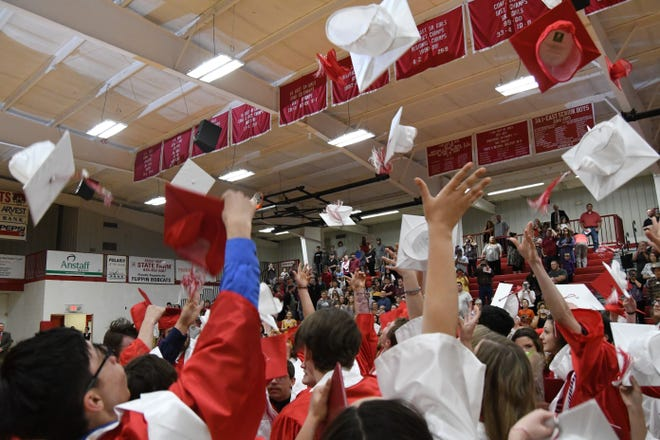 Members of Flippin's Class of 2019 toss their caps into the air to conclude last year's graduation ceremony. The Class of 2020 will receive a belated graduation ceremony this Saturday night.
