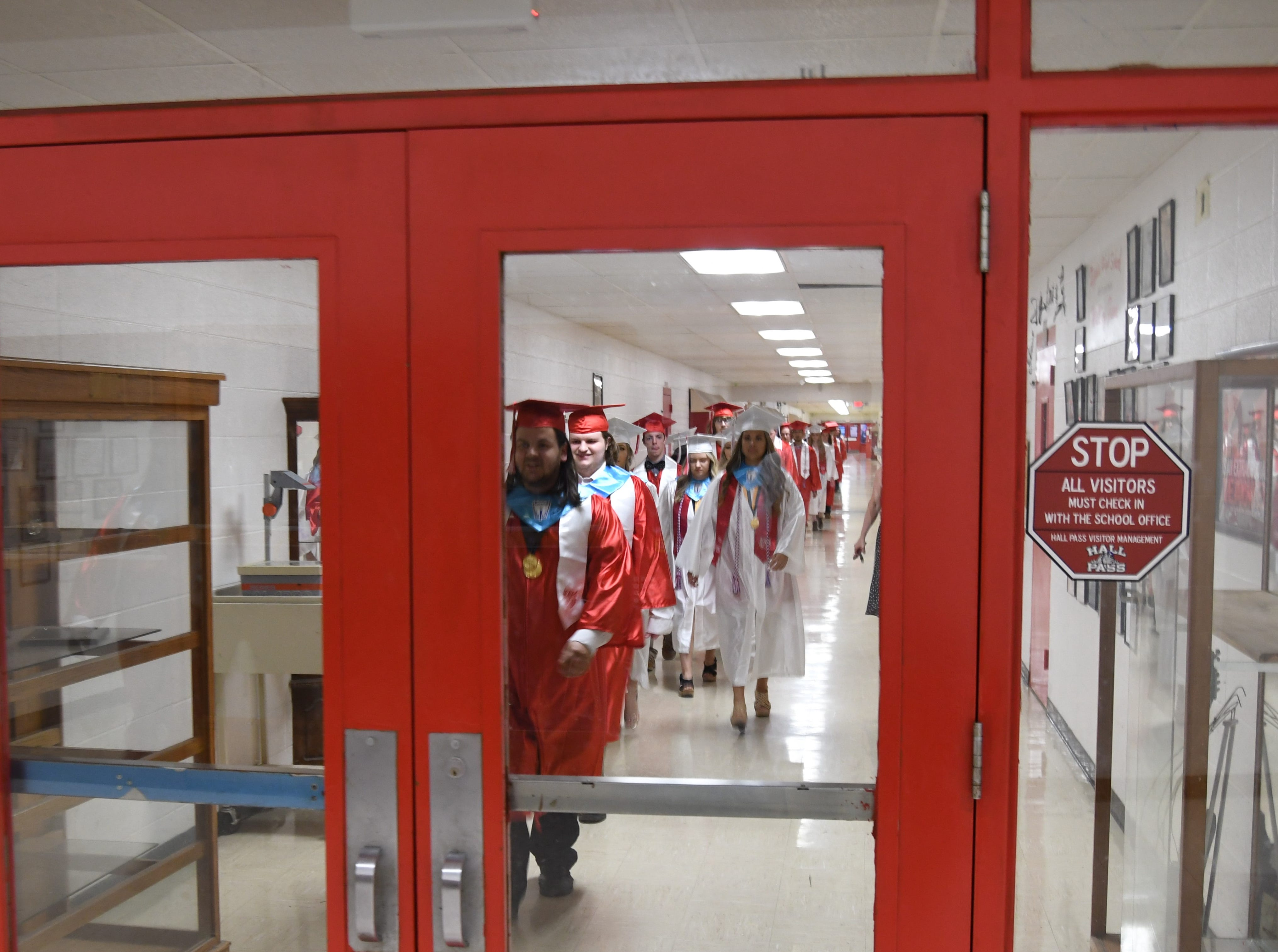 Flippin's seniors approach the school's gym to march in for graduation Friday night.
