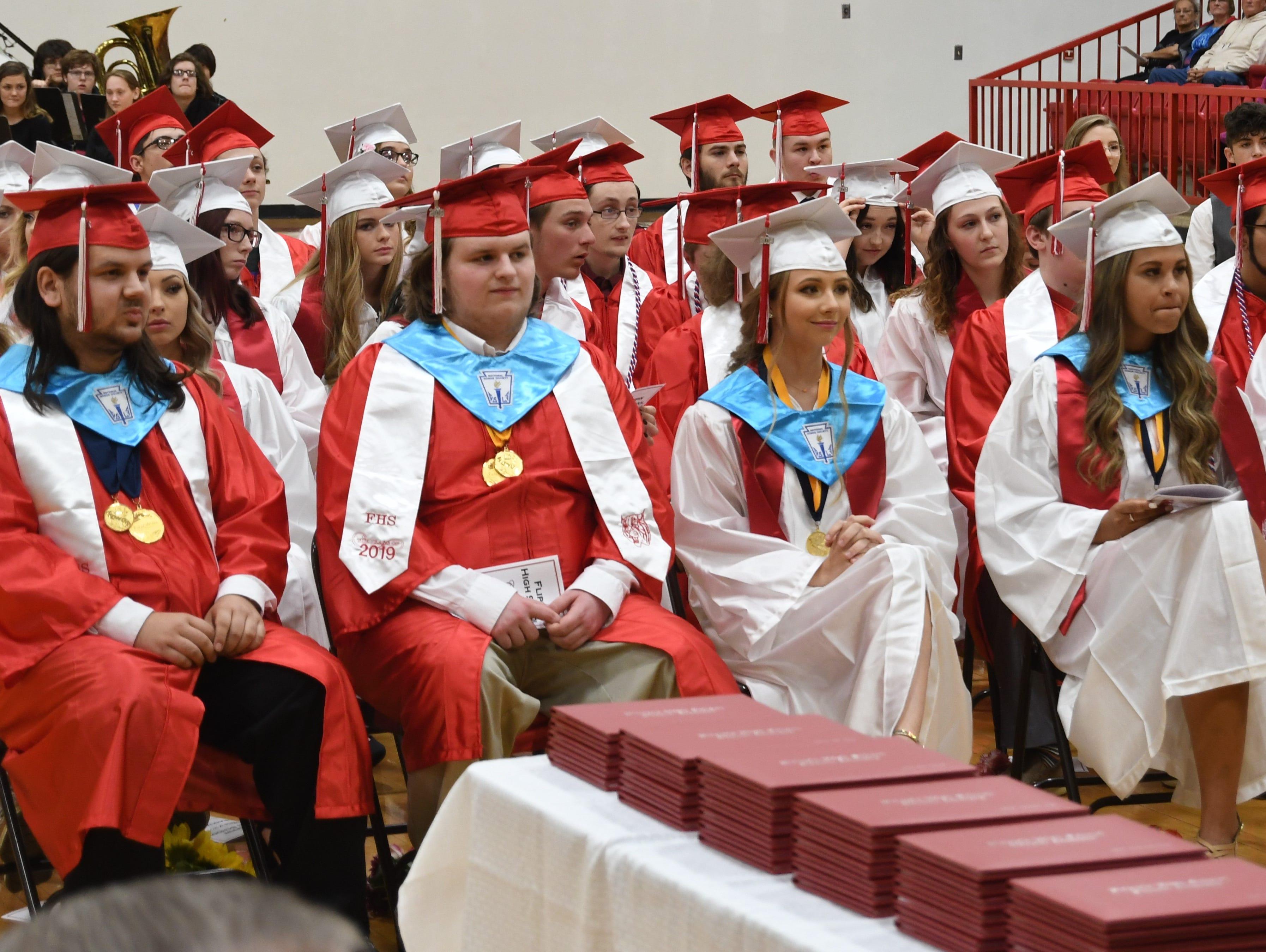 Flippin graduates watch a slideshow presentation Friday night during graduation.