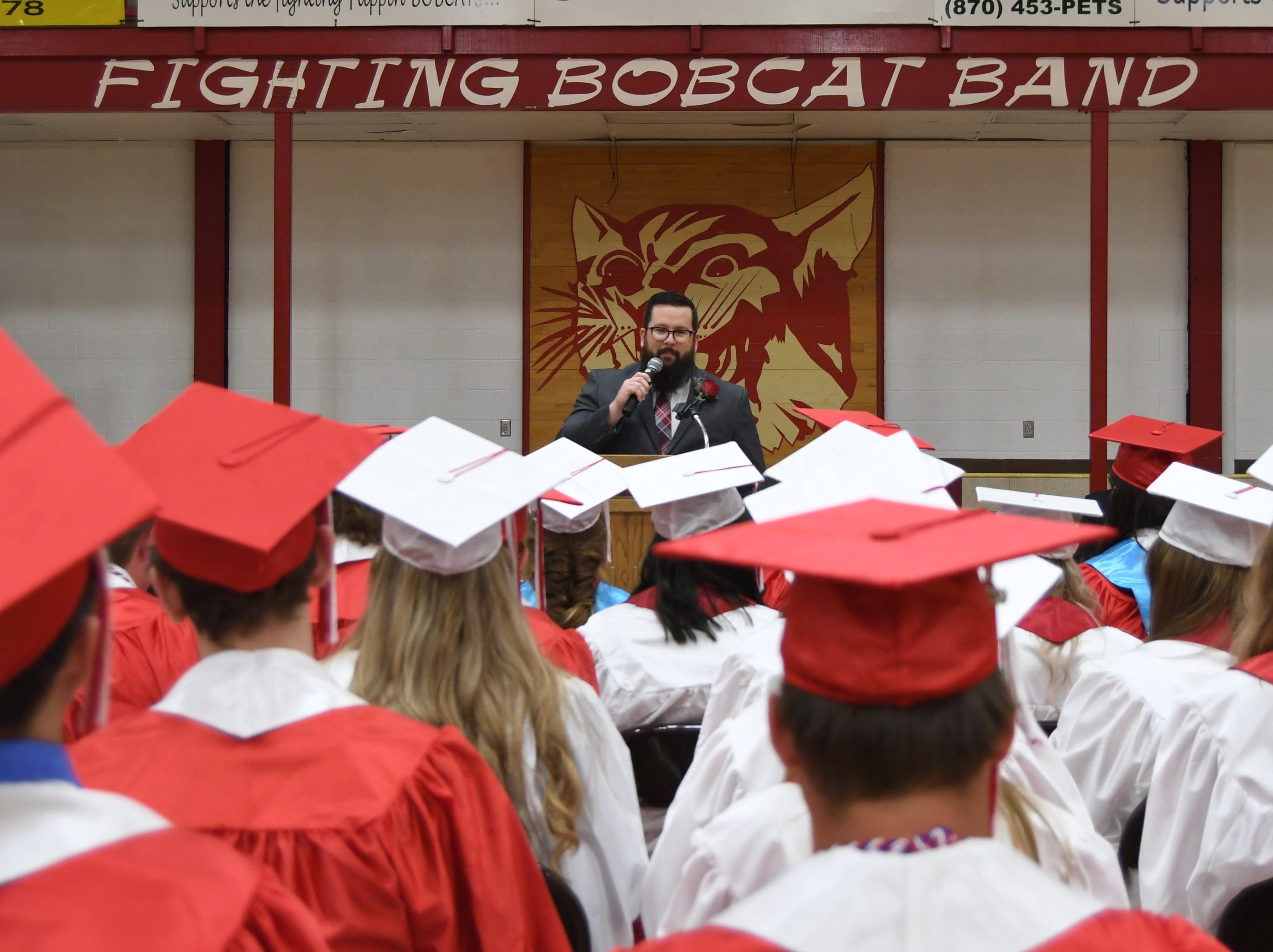 High school business teacher Jessie Jefferson addresses Flippin's senior class Friday night during graduation.