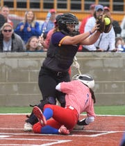 Melbourne's Reagan Rapert slides into home safely under the tag of Poyen catcher Roo Pumphrey for an inside-the-park home run on Saturday at McClain Park.