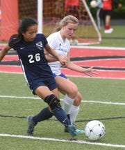 Mountain Home's Kirsten Stroud (right) battles Little Rock Christian's Madison Stockwell on Friday at Searcy.