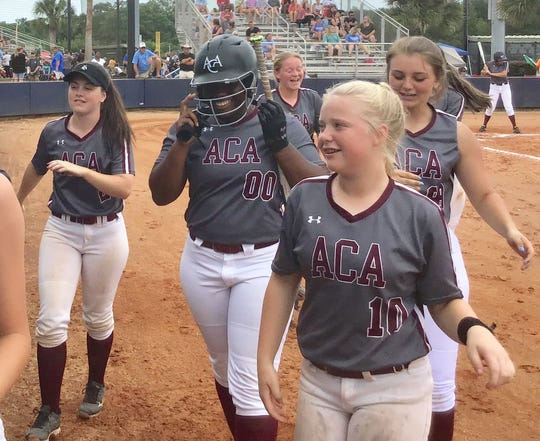 Alabama Christian's Aniya Jackson is all smiles after a home run against Dale County.