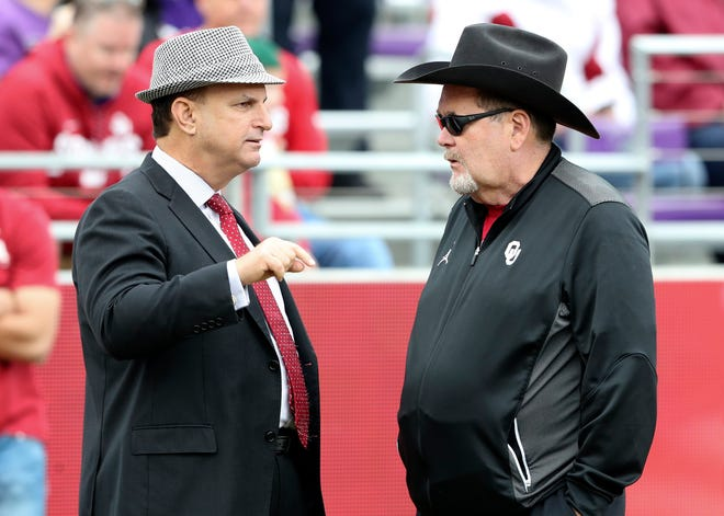 Oct 20, 2018; Fort Worth, TX, USA; Oklahoma Sooners athletic director Joe Castiglione speaks with former WWE host Jim Ross (right) before the game against the TCU Horned Frogs at Amon G. Carter Stadium. Mandatory Credit: Kevin Jairaj-USA TODAY Sports