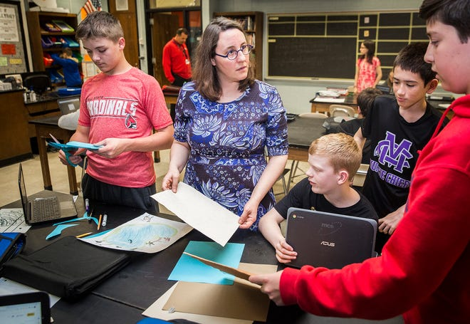 Award-winning science teacher Erica Collins instructs students in her classroom at Northside Middle School in Muncie in this file photo.