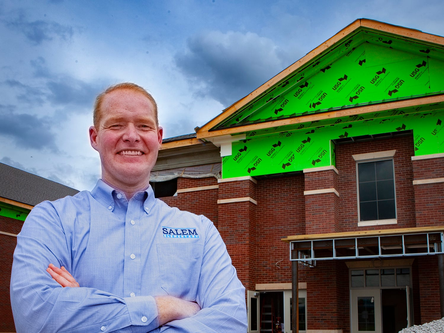 Salem Elementary Principal Trey Duke stands outside the school's construction site. Murfreesboro City Schools' 13th campus will open in July 2019.