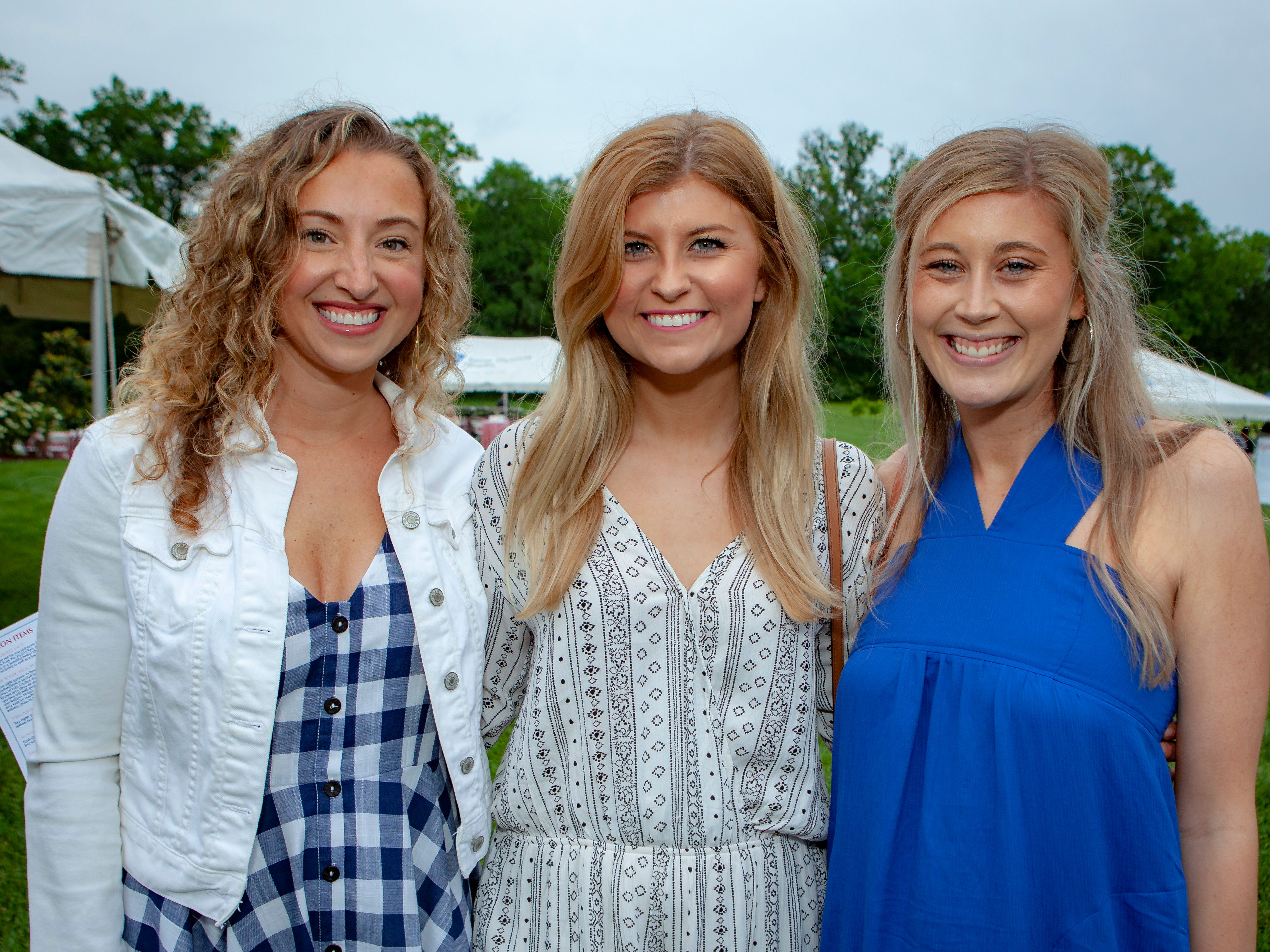 Marcie Rainey, Olivia Wright and Aubrey Grensing enjoyed a Cajun feast under the stars at United Way's Red, White and Bayou, held Friday, May 10, 2019 at the home of Jimmy & Nikkole Aho.