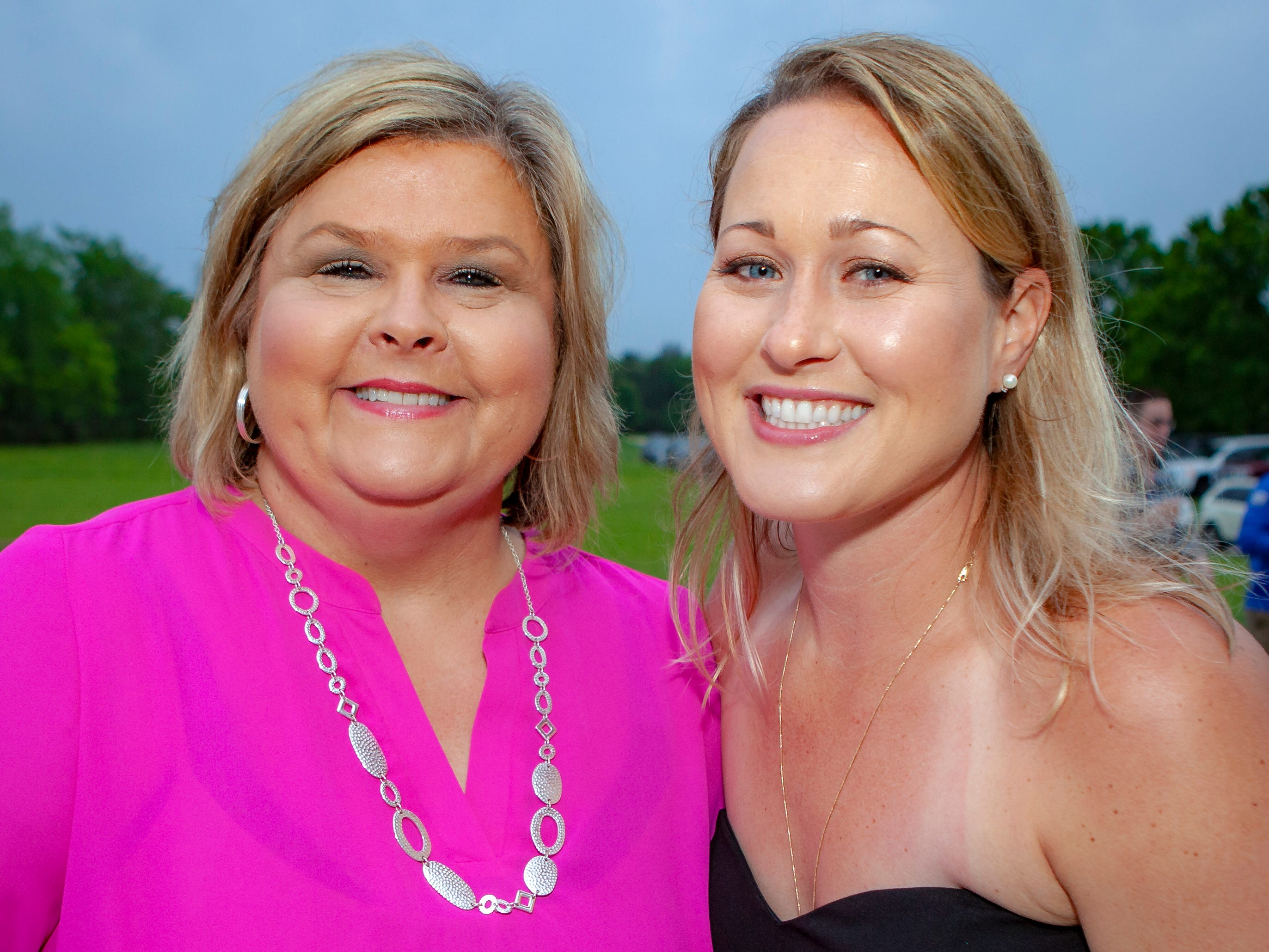 Kathy Smith and Dawn Dampier enjoyed a Cajun feast under the stars at United Way's Red, White and Bayou, held Friday, May 10, 2019 at the home of Jimmy & Nikkole Aho.