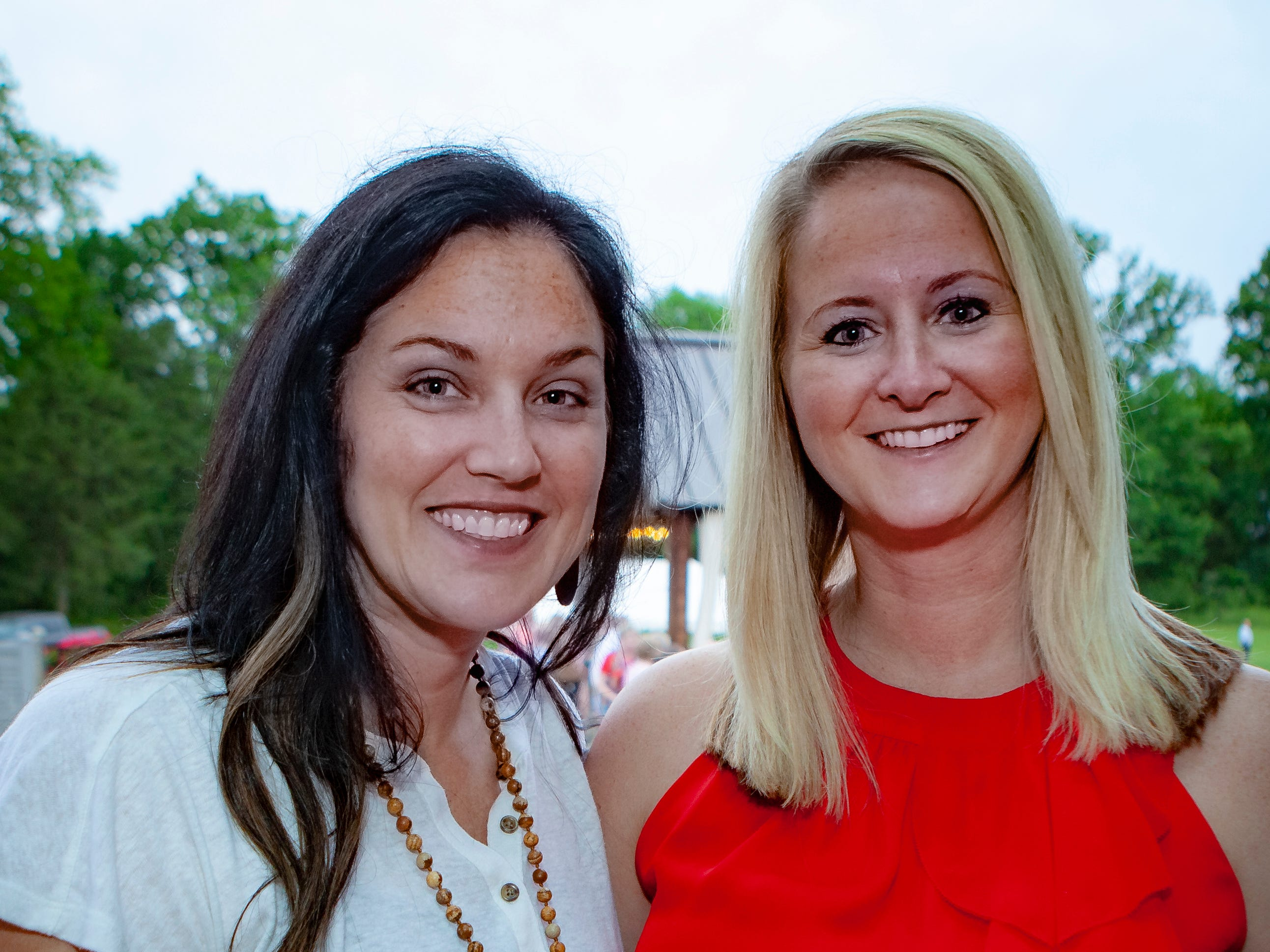 Lauren Fluharty and Barbara Garrett enjoyed a Cajun feast under the stars at United Way's Red, White and Bayou, held Friday, May 10, 2019 at the home of Jimmy & Nikkole Aho.