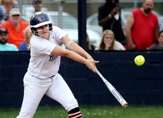 Blackman's Rachel Tarpley (14) hits the ball during the 7-AAA District Championship game against Siegel at Oakland on Friday, May 10, 2019.