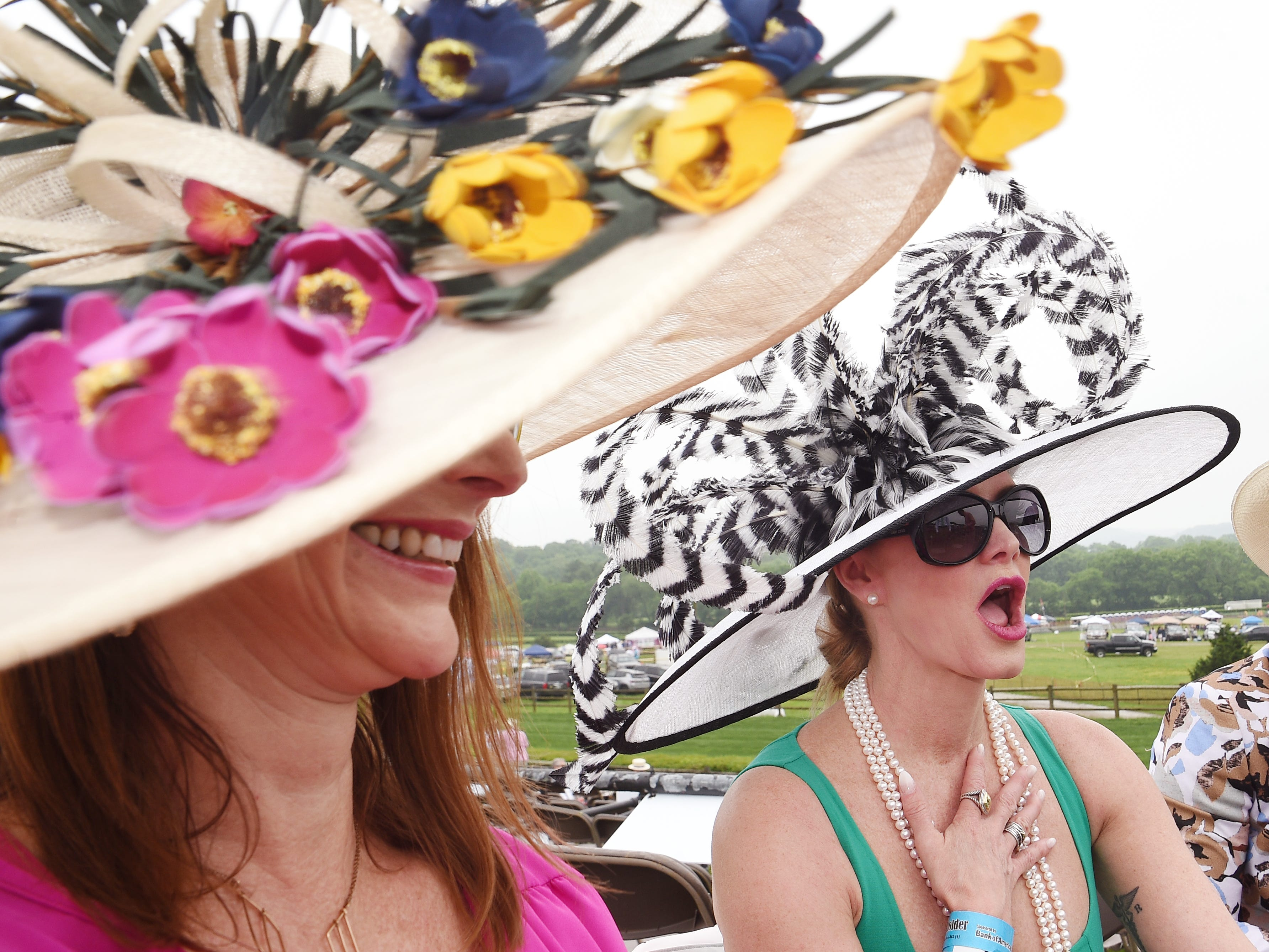 Rebecca Lines and Katherine Morgan wait for the 78th Iroquois Steeplechase races to begin at Percy Warner Park in Nashville on Saturday May 11, 2019.