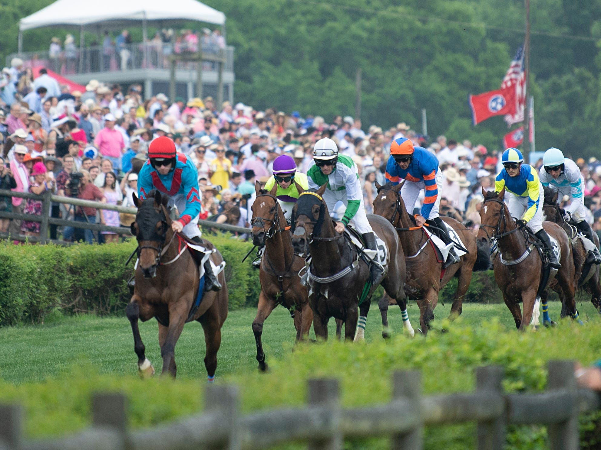 Fans watch as horses race during the 78th Iroquois Steeplechase at Percy Warner Park in Nashville on Saturday, May 11, 2019.