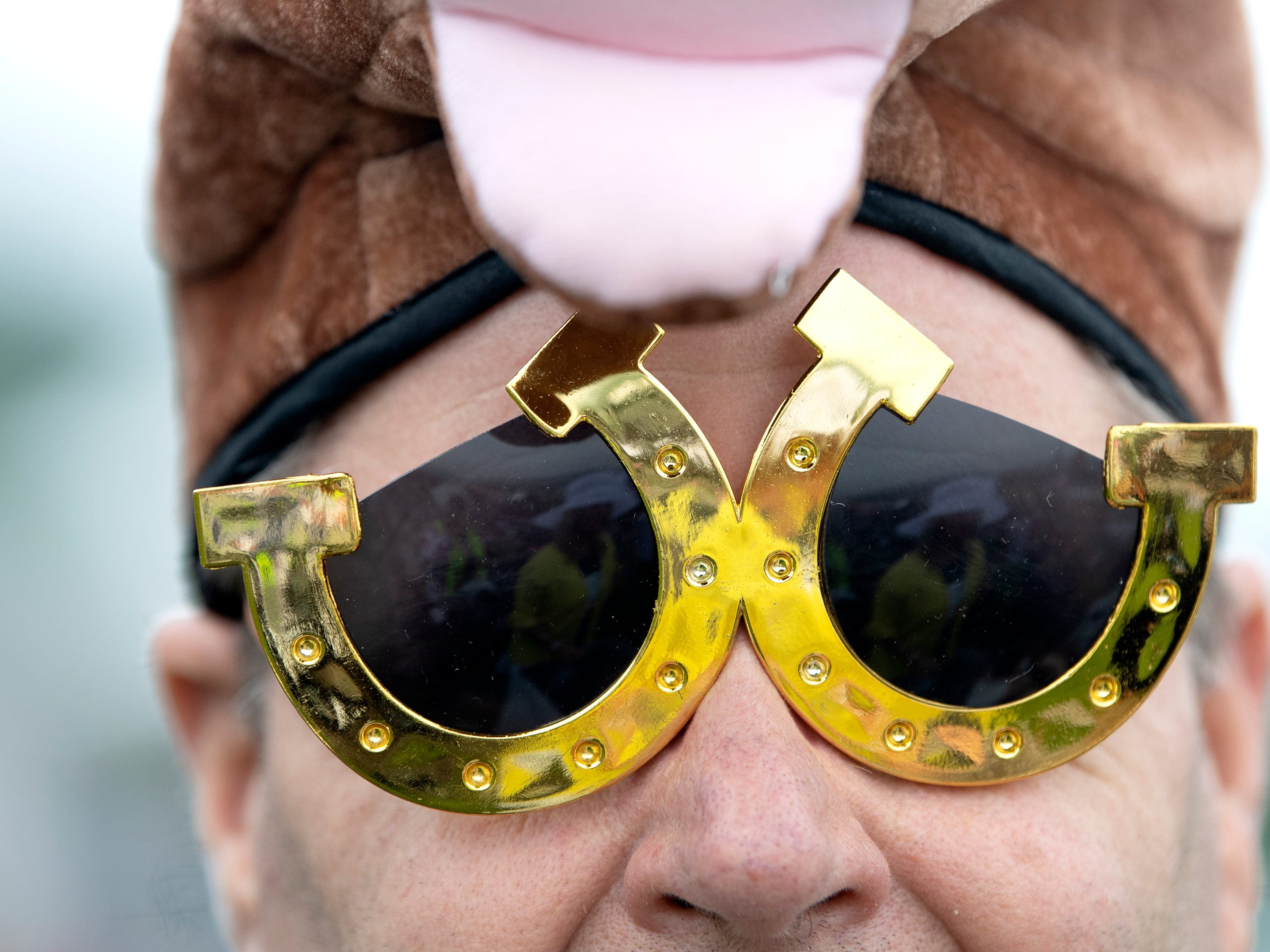 Charlie Brown of Franklin wears horseshoe sunglasses at the 78th Iroquois Steeplechase at Percy Warner Park in Nashville on Saturday, May 11, 2019.