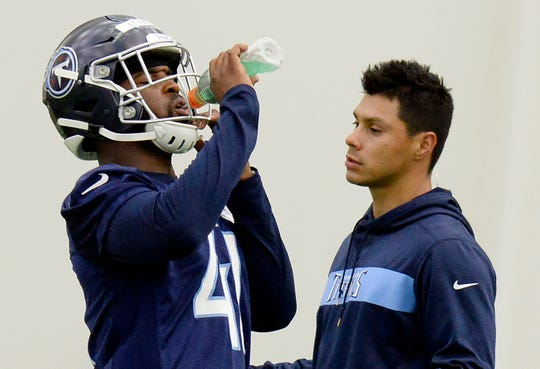 Tennessee Titans linebacker David Long (41) drinks during rookie minicamp Saturday, May 11, 2019.