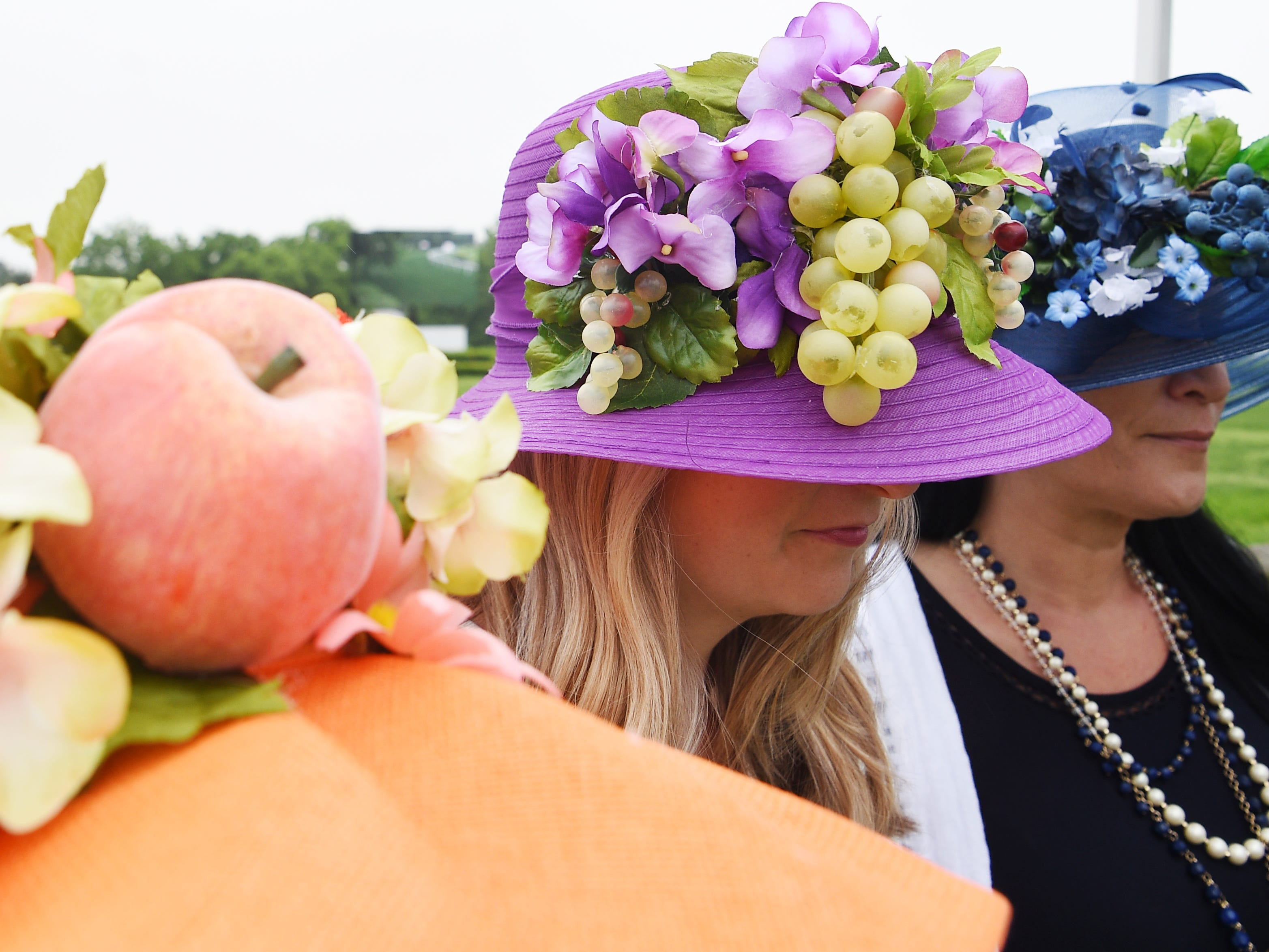 Casey Williams, Amanda Hurley, and Diana Sanderson wear handmade hats at the 78th Iroquois Steeplechase at Percy Warner park in Nashville on Saturday, May, 11, 2019.