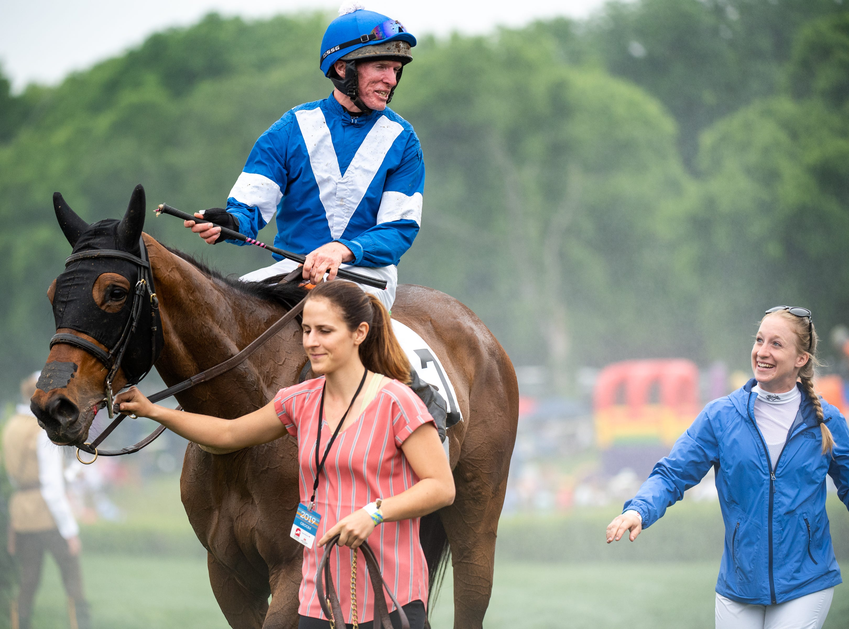 Gerard Galligan smiles on thoroughbred horse, Sportswear, after winning the first race of the Iroquois Steeplechase at Percy Warner Park Saturday, May 11, 2019, in Nashville, Tenn.