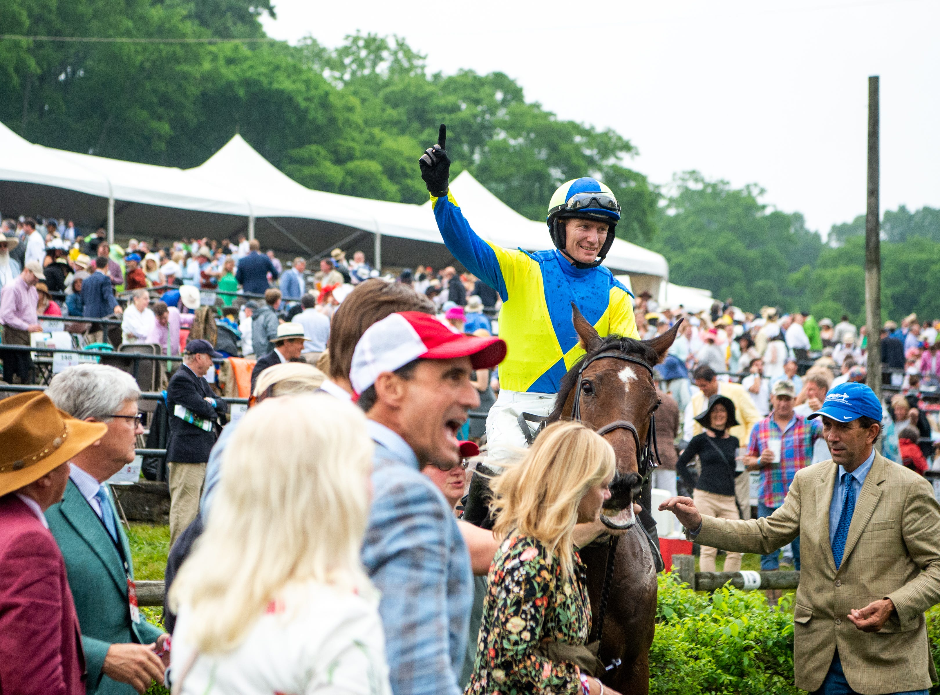 Sean McDermott and Scorpiancer celebrate after winning the final race of the Iroquois Steeplechase at Percy Warner Park Saturday, May 11, 2019, in Nashville, Tenn.