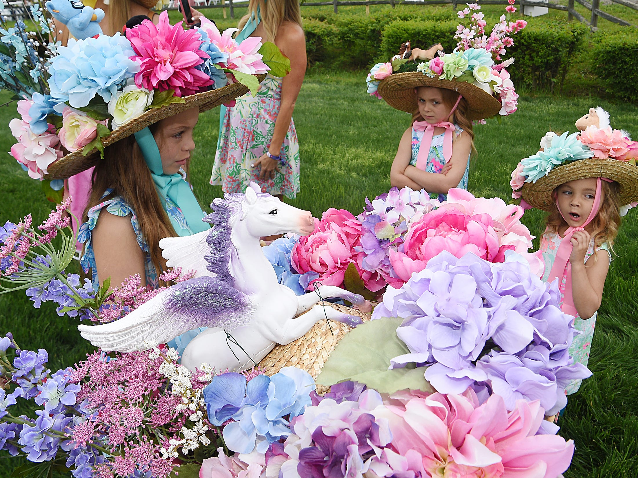 The Reimold family of Franklin designed and made their own hats for the 78th Iroquois Steeplechase at Percy Warner Park in Nashville on Saturday May 11, 2019.