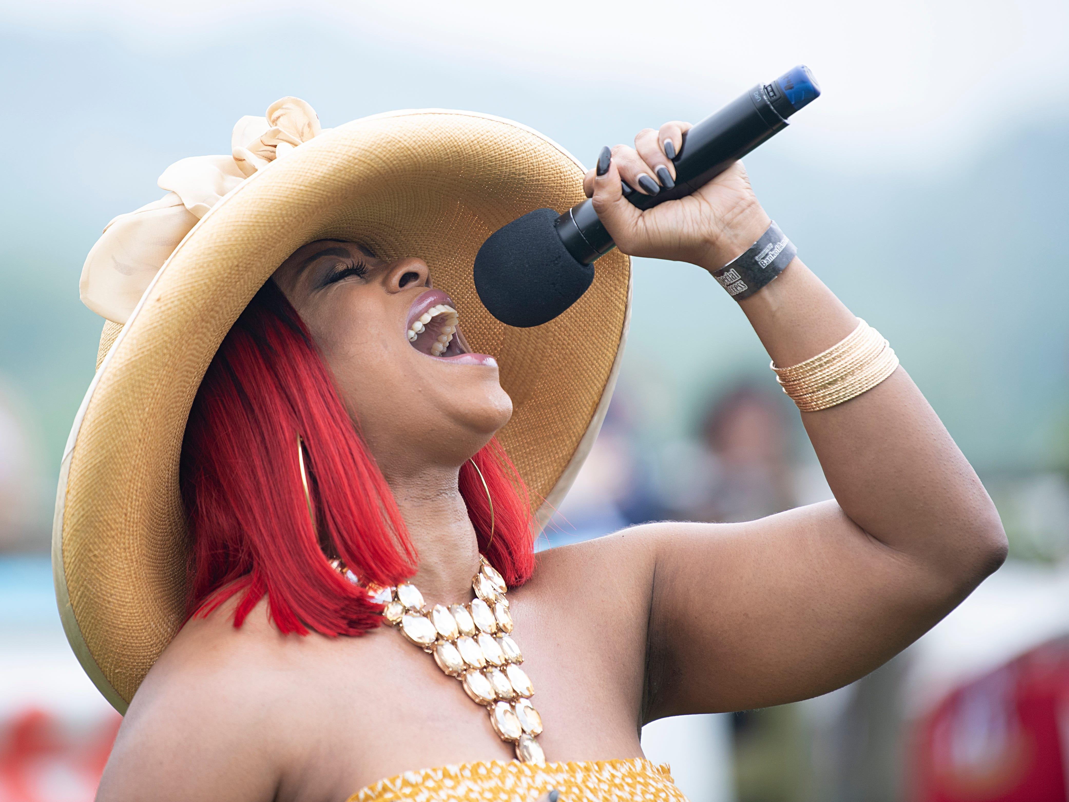 Singer Keesha Rainey performs the National Anthem during the 78th Iroquois Steeplechase at Percy Warner Park in Nashville on Saturday, May. 11, 2019.