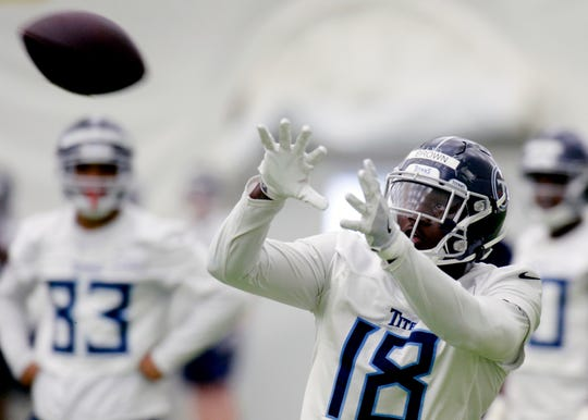 Tennessee Titans wide receiver A.J. Brown (18) catches a pass during NFL football rookie minicamp Saturday, May 11, 2019, in Nashville, Tenn.