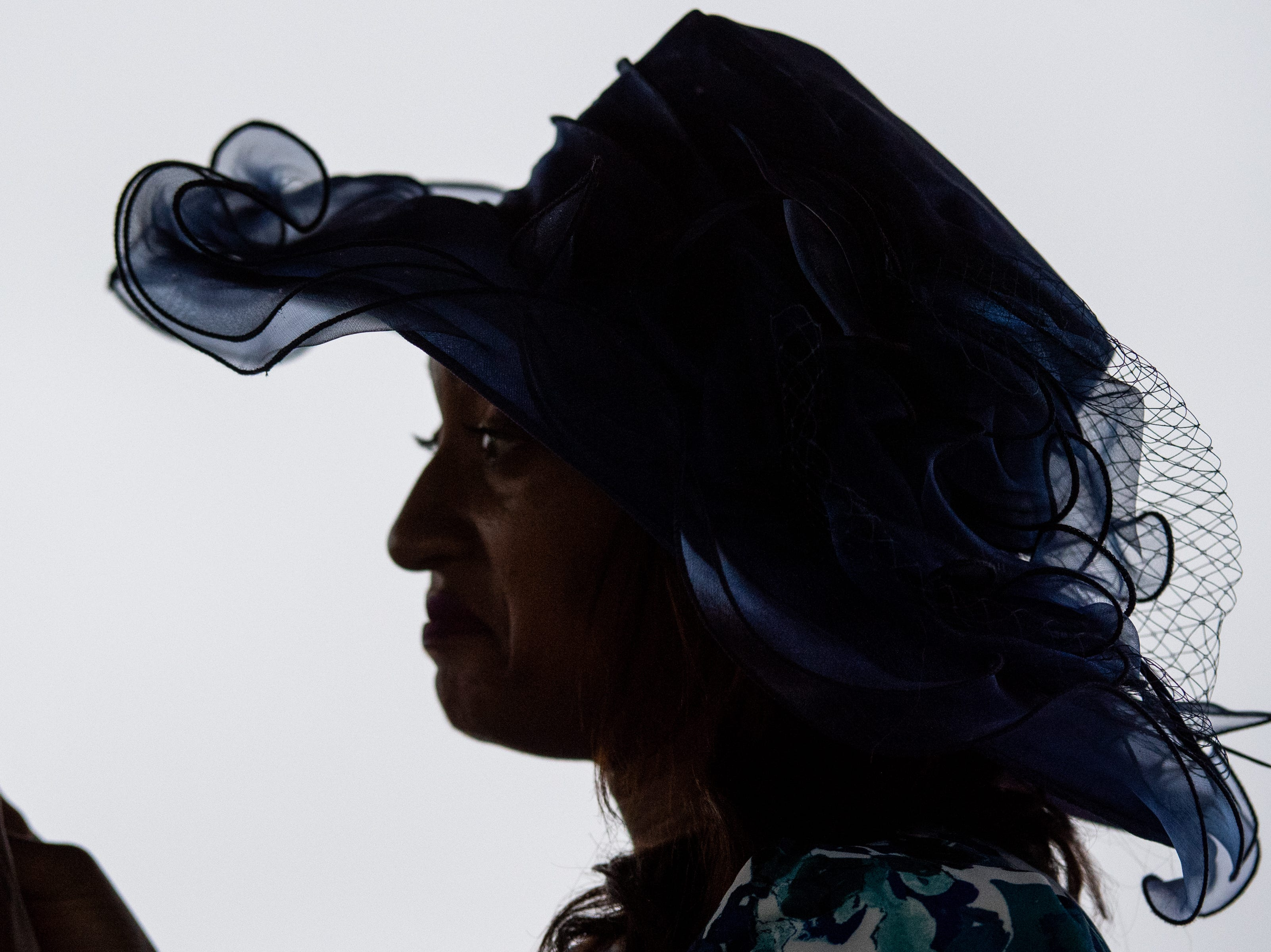 A woman wears a hat before the final race of the Iroquois Steeplechase at Percy Warner Park Saturday, May 11, 2019, in Nashville, Tenn.