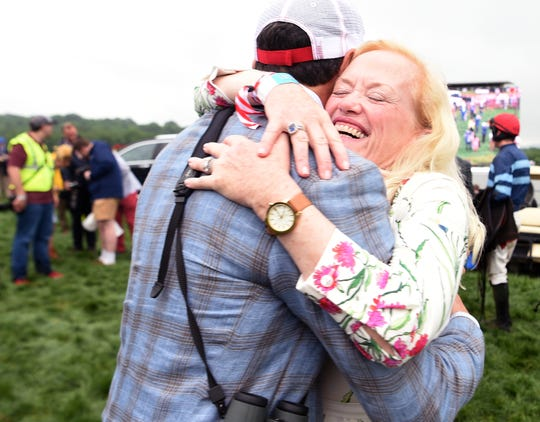 Owner Ann Hankin celebrates after Scorpiancer won The Calvin Houghland Iroquois at the 78th Iroquois Steeplechase at Percy Warner Park in Nashville on Saturday, May 11, 2019.