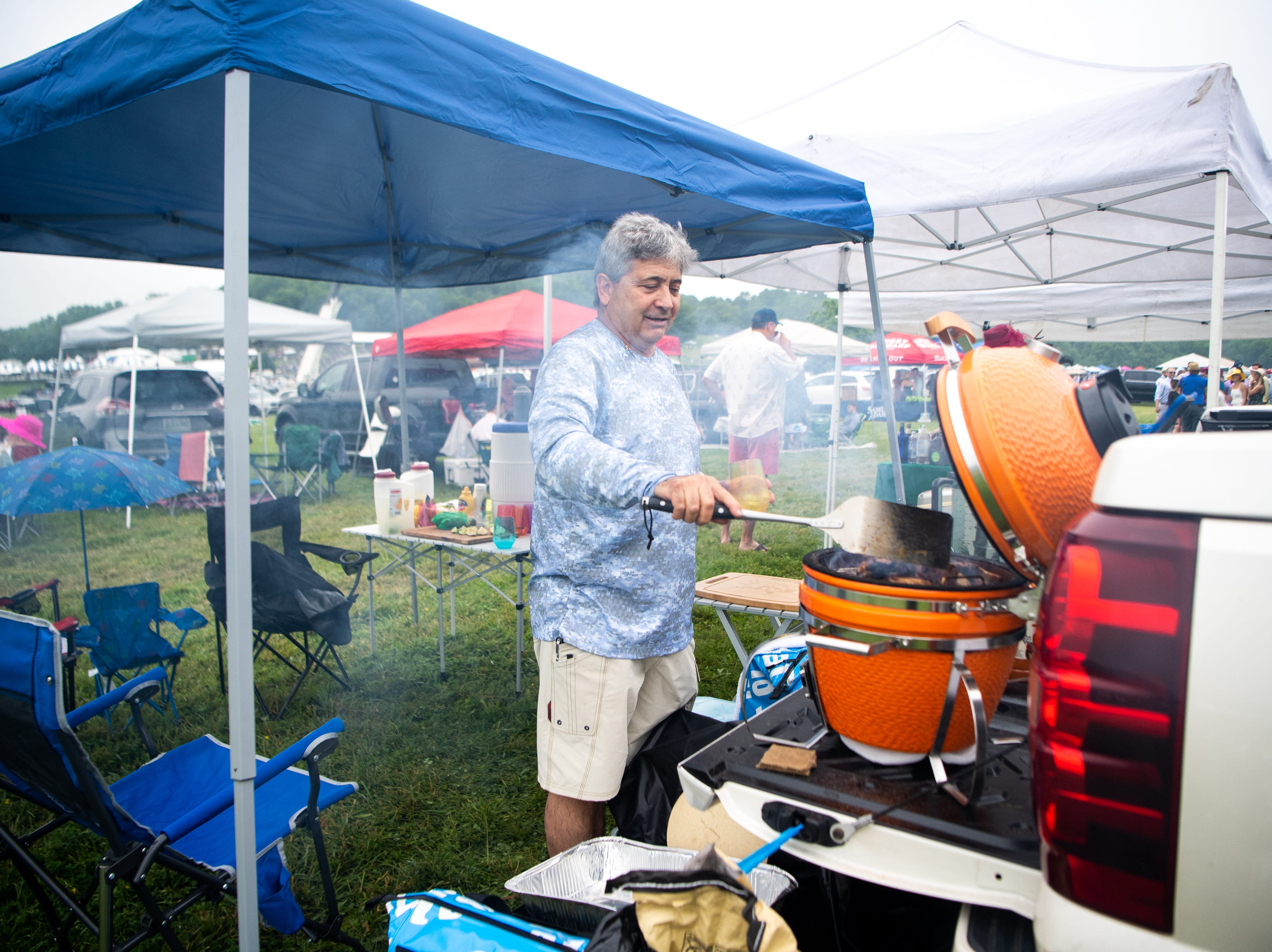 Carl Maltese grills during the Iroquois Steeplechase at Percy Warner Park Saturday, May 11, 2019, in Nashville, Tenn.