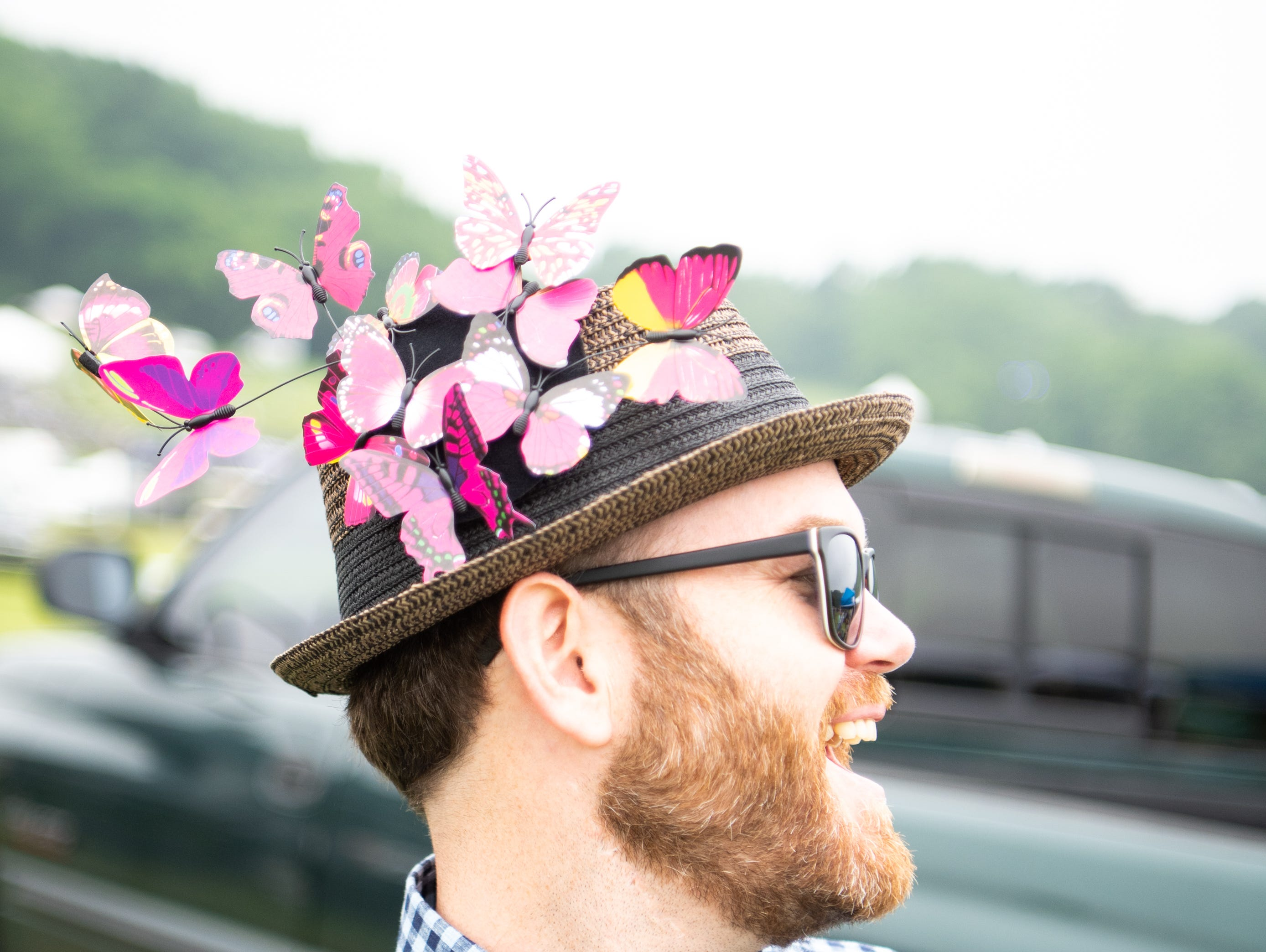 Matthew Meadows wears a butterfly hat during the Iroquois Steeplechase at Percy Warner Park Saturday, May 11, 2019, in Nashville, Tenn.