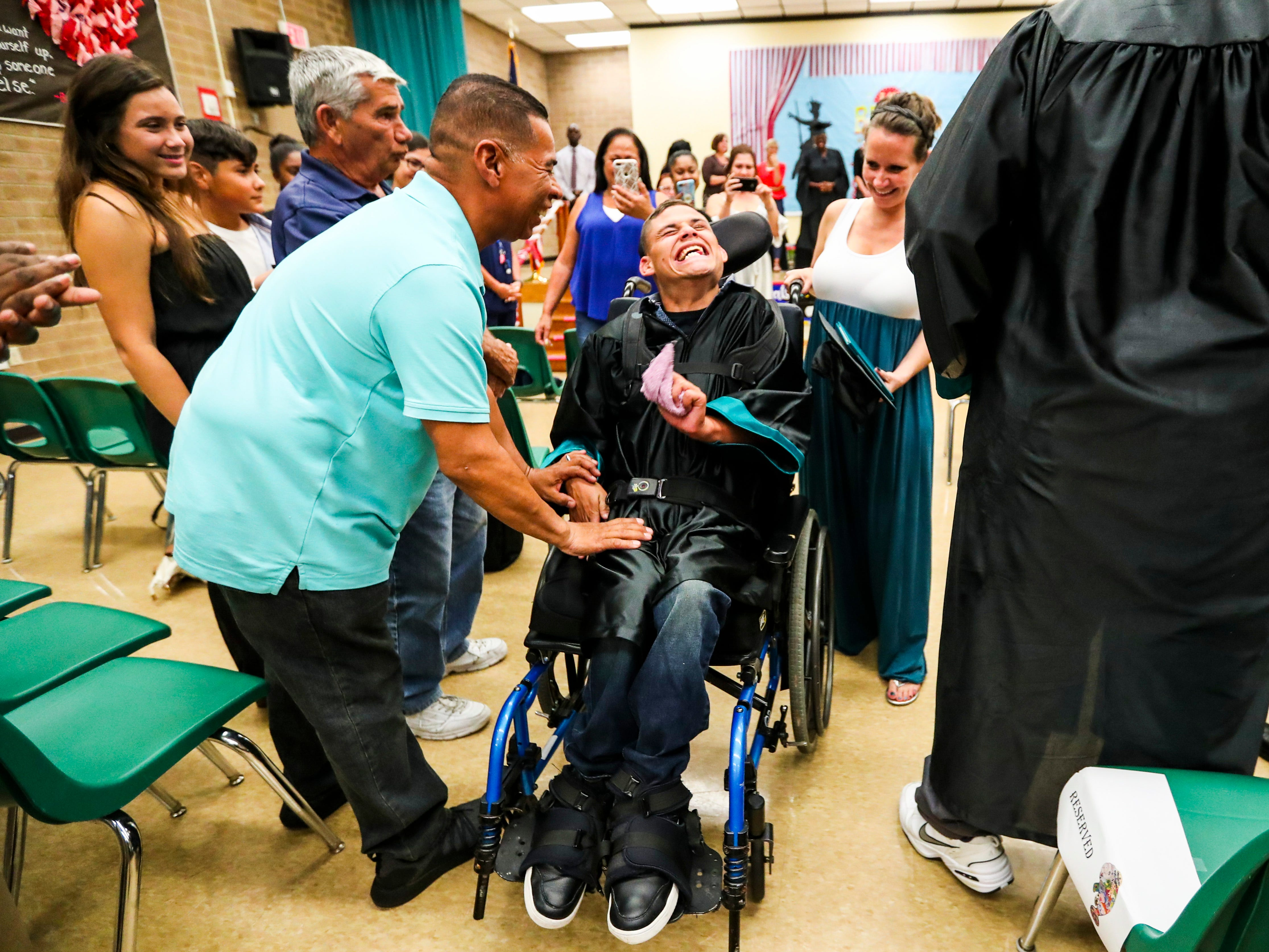 Melvin Reyes reacts to seeing his family as he leaves the ceremony. 13 students at Buckingham Exceptional Student Center graduated during a ceremony in their honor. Family, friends, and staff were there to honor the graduates.