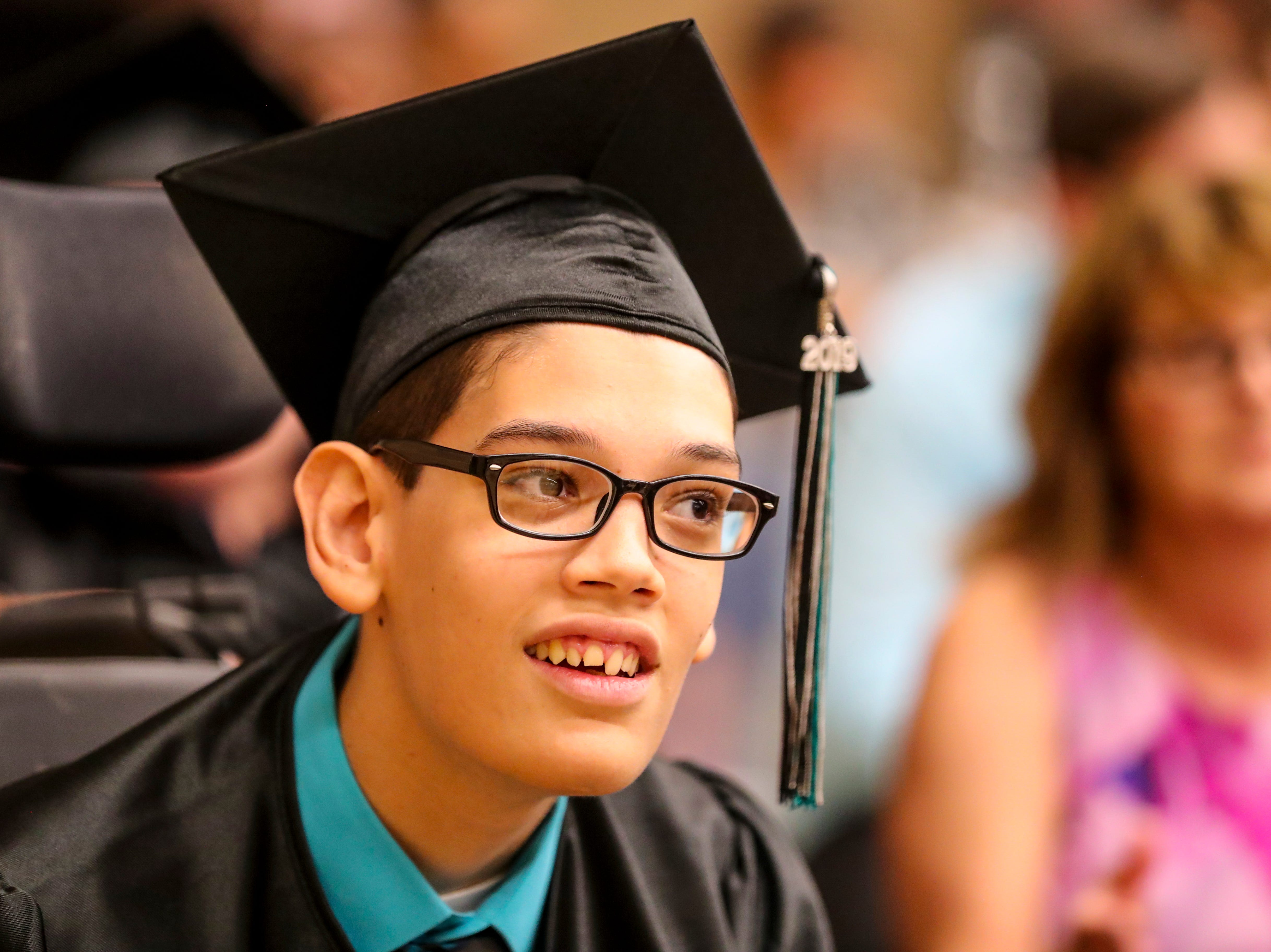 David Upton graduated with his class. 13 students at Buckingham Exceptional Student Center graduated during a ceremony in their honor. Family, friends, and staff were there to honor the graduates.