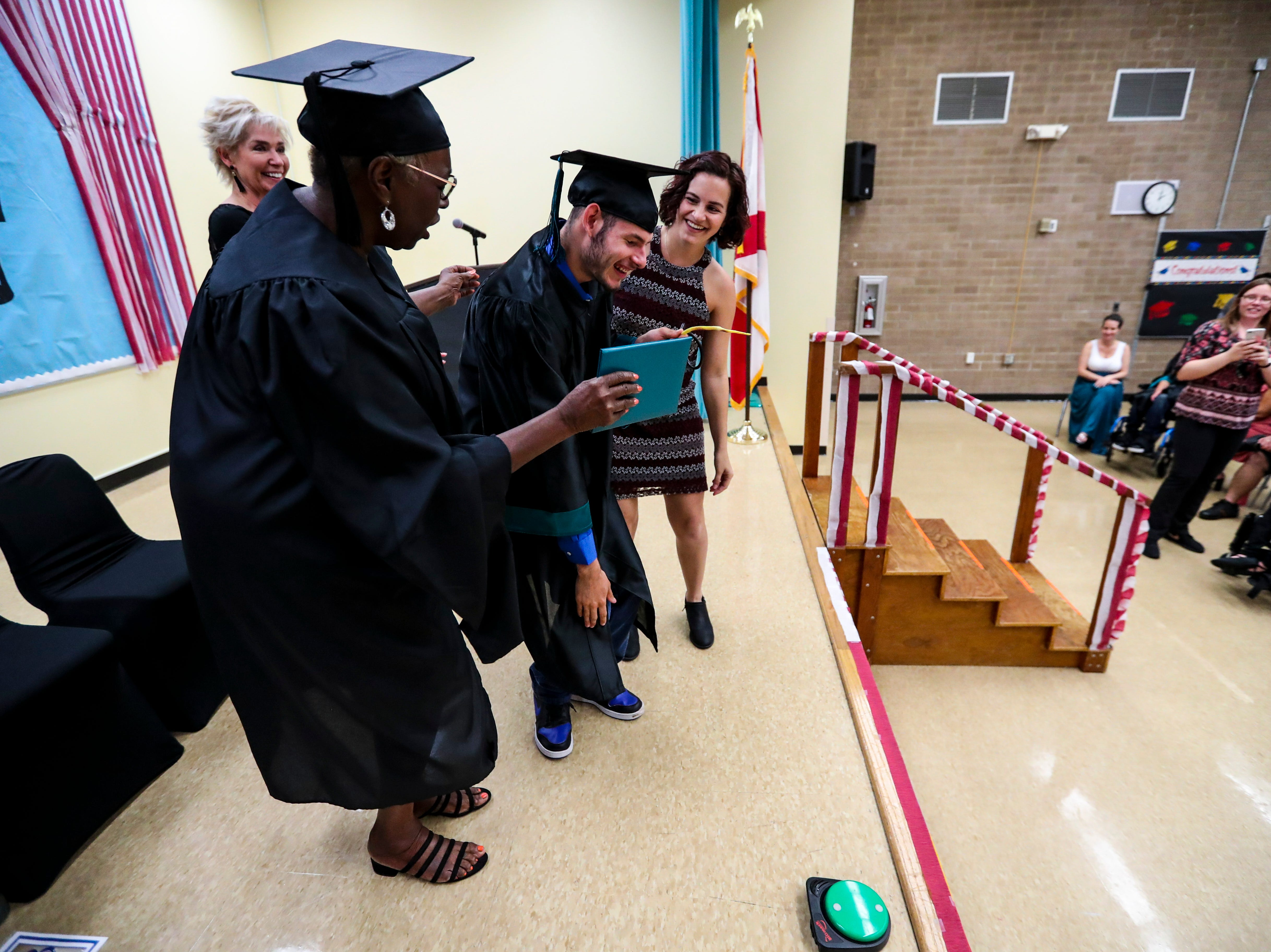 13 students at Buckingham Exceptional Student Center graduated during a ceremony in their honor. Family, friends, and staff were there to honor the graduates.