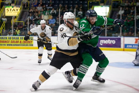Newfoundland Growlers forward Garrett Johnston and Florida Everblades forward Justin Auger chase down the puck during Game 1 of the ECHL Eastern Conference Finals on Friday. The Growlers won Game 2, 5-1, on Saturday night to take a 2-0 series lead.