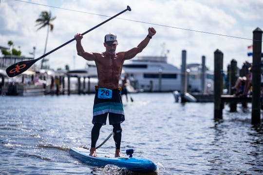 Mark Athanacio from Bonita Springs wins the professional paddleboard race Saturday, May 11, 2019, during the 43rd annual Great Dock Canoe Race at Crayton Cove in Naples.