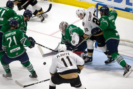Florida Everblades help their goalie Callum Booth defend the net against an attack by the Newfoundland Growlers during Game 1 of the ECHL Eastern Conference Finals on Friday at Hertz Arena. Florida lost, 2-0.